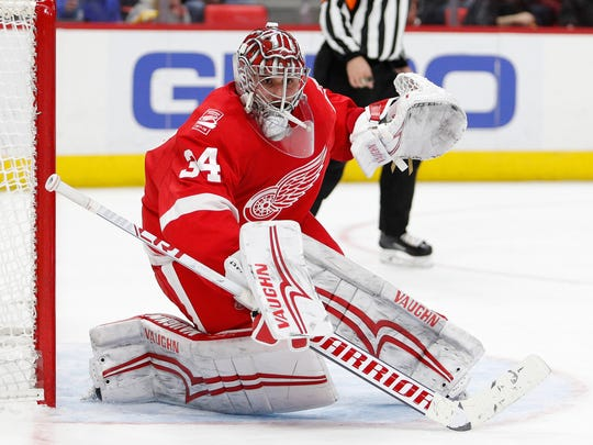 Red Wings goaltender Petr Mrazek (34) protects the net during the third period of the Wings' 5-2 loss on Sunday, Jan. 7, 2018, at Little Caesars Arena.