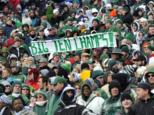 MSU fans celebrate the Spartans' Big Ten championship-clinching win at Penn State on Nov. 27, 2010.