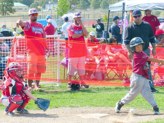 Batter up on a previous Memorial Day weekend in a series of tournaments coordinated by the Ruidoso Parks and Recreation Department.