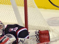 St. Cloud State goaltender Charlie Lindgren pounces on a shot by Miami of Ohio's Sean Kuraly (9) during the first period of the NCHC Frozen Faceoff championship game Saturday at the Target Center in Minneapolis.