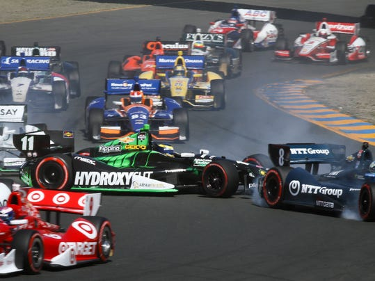 Sebastien Bourdais, (11), loses control and collides with Ryan Briscoe, (8), during the GoPro Grand Prix of Sonoma IndyCar series auto race, Sunday, Aug. 24, 2014, in Sonoma, Calif. (AP Photo/Elijah Nouvelage)
