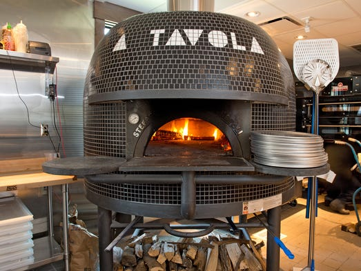 Take a look inside A Tavola Pizza's newly opened second location, in Madeira. A Tavola makes their pizzas in a wood burning oven.