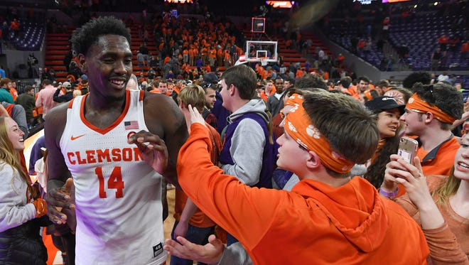Clemson forward Elijah Thomas (14) celebrates with students after the Tigers 82-78 win over North Carolina on Tuesday, January 30,  2018, at Clemson's Littlejohn Coliseum.