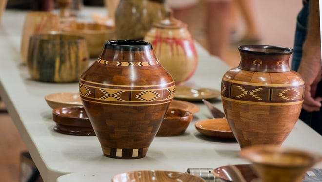 Pieces are displayed July 21 at the Artistic Woodturners of Northwest Florida's meeting at Ragon Hall.