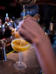 A handcrafted cocktail is prepared at UnderTow, the