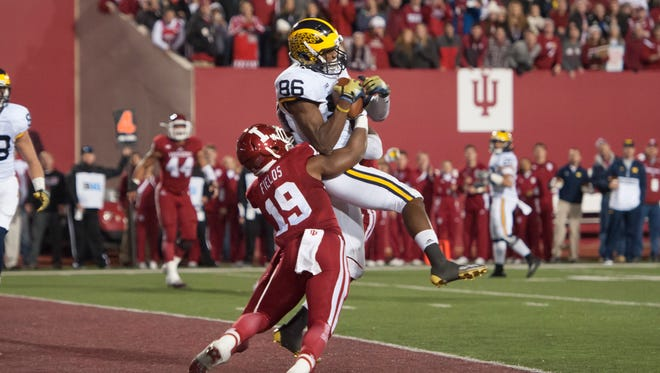 Jehu Chesson catches the TD pass that sent the game into overtime Saturday at Indiana.