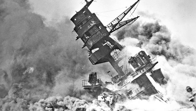 The USS Arizona during the bombing of Pearl Harbor by the Japanese.