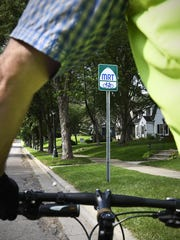 Signs are posted along the trail for riders on the Mississippi River Trail that runs through St. Cloud. The Mississippi River Trail runs from Itasca State Park to the Gulf of Mexico.