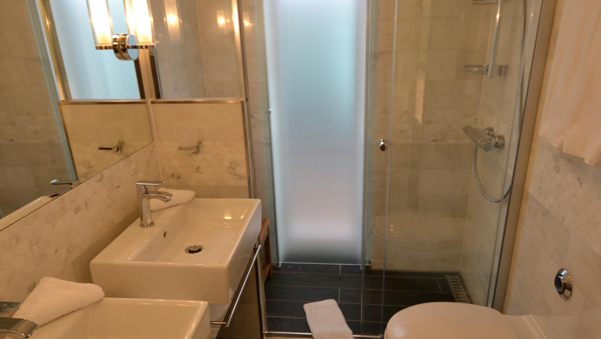 Explorer Suite bathrooms feature two sinks and large walk-in showers.