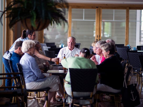 Patrons sit down for lunch at the Ocean Pines Yacht Club.