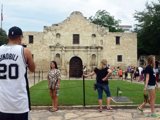 FILES - A man wearing a San Antonio Spurs jersey with