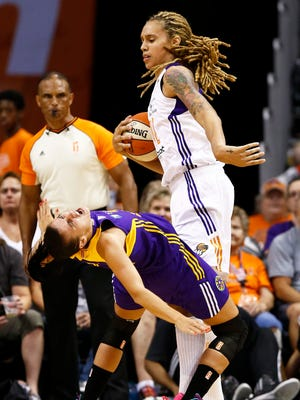 Phoenix Mercury center Brittney Griner is called for a technical foul after hitting Los Angeles Sparks defender Ana Dabovic with an elbow on Friday, Aug. 21, 2015, at US Airways Center in Phoenix.