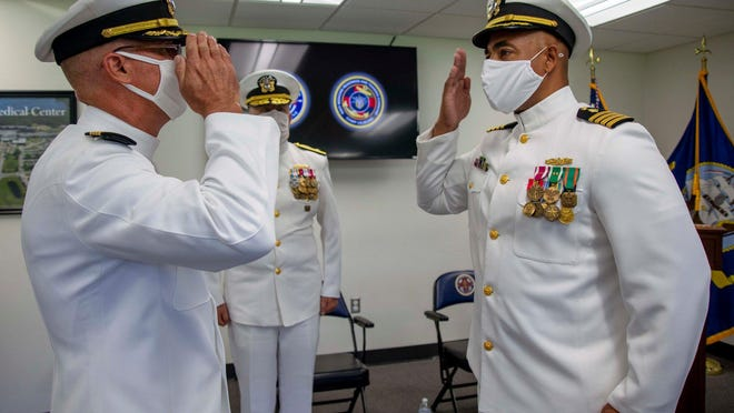 U.S. Navy Capt. Jeffrey W. Timby (left) relinquished command of Naval Medical Center Camp Lejeune to Capt. Reginald S. Ewing III (right) during a change of command ceremony on Marine Corps Base Camp Lejeune, N.C., July 16, 2020. Rear Admiral Darin K. Via (center), Commander, Naval Medical Forces Atlantic, was the presiding officer.