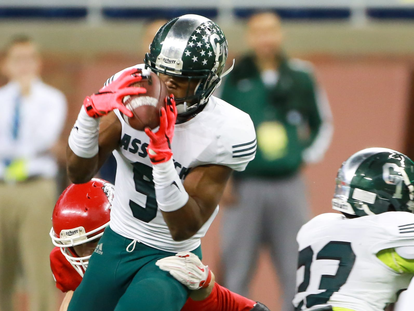 Detroit Cass Tech Donovan People-Jones catches a pass, during the first half of the Michigan High School Athletic Association football Division 1 finals at Ford Field in Detroit on Saturday, Nov. 28, 2015.