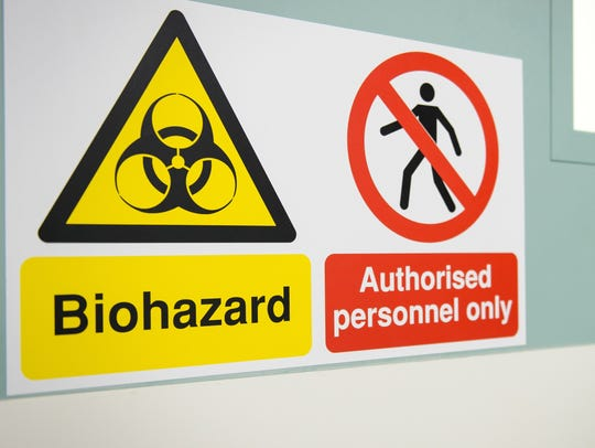 A sign warns of the biohazard threat outside a secure