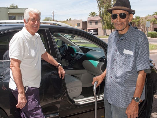 Jon Allen, a volunteer with Duet, helps give rides