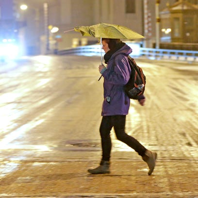 Stevens point journal a woman crosses a slushy w state st at n old world fandeluxe Gallery