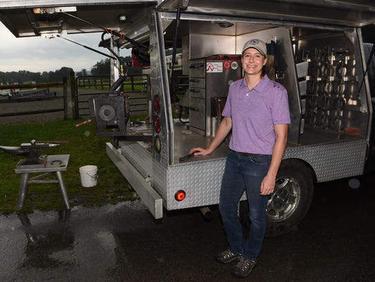 Elke Albrecht, a farrier, pictured with a mobile farrier