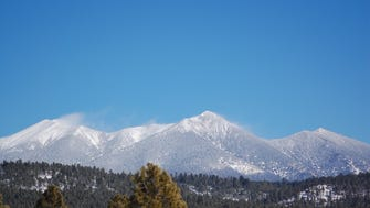 This photo shows the San Francisco Peaks near Flagstaff early Sunday after overnight snow.