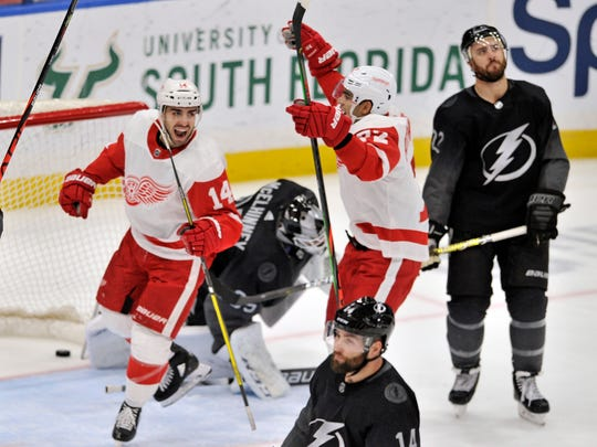 Detroit Red Wings' Robby Fabbri (14) and Brian Lashoff (342) celebrate Fabbri's goal between Tampa Bay Lightning goalie Andrei Vasillevskly (35), Pat Maroon (14) and Kevin Shattenkirk (22)during the second period of an NHL hockey game Sunday, Dec. 29, 2019, in Tampa, Fla. (AP Photo/Steve Nesius)