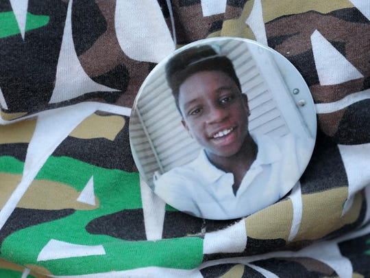 A button was worn in honor of teenager Andre Green during an August vigil on Monument Circle.