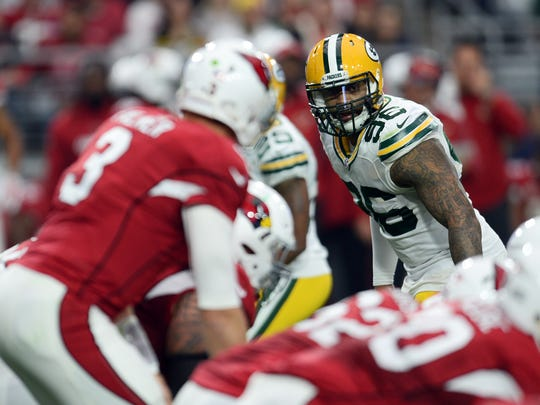 Green Bay Packers outside linebacker Mike Neal (96) looks down Arizona Cardinals quarterback Carson Palmer (3).
