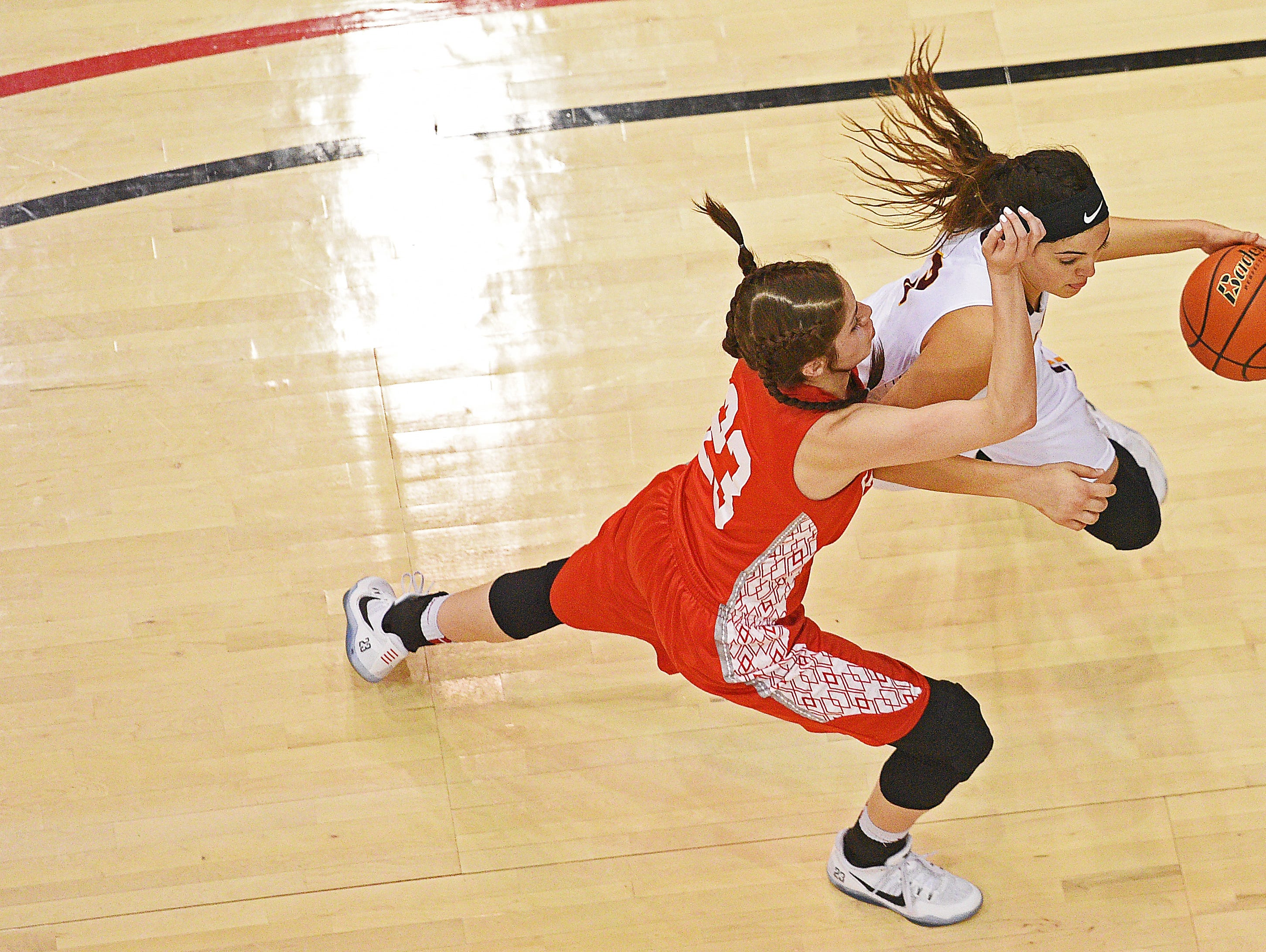 Harrisburg's Sami Slaughter (3) dribbles past Rapid City Central's Mya Jones (23) during a 2017 SDHSAA Class AA State Girls Basketball semifinal game Friday, March 17, 2017, at Rushmore Plaza Civic Center in Rapid City. Harrisburg beat Rapid City Central 49-44, and will play in Saturday's final.