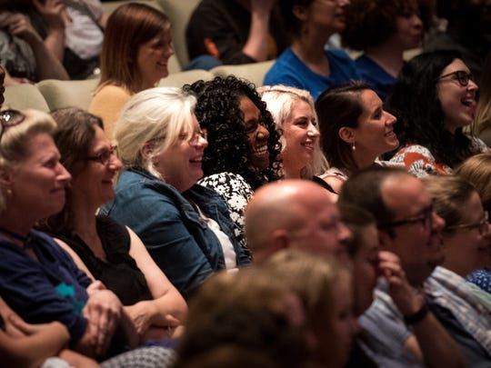 The audience laughs as author Roxane Gay speaks at