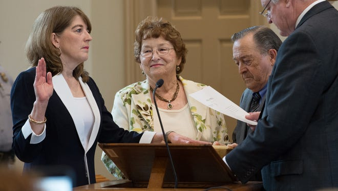 The Honorable Louann Vari, left, being sworn in as a Judge of The Family Court of The State of Delaware during her investiture ceremony at the Kent Count Courthouse in Dover.