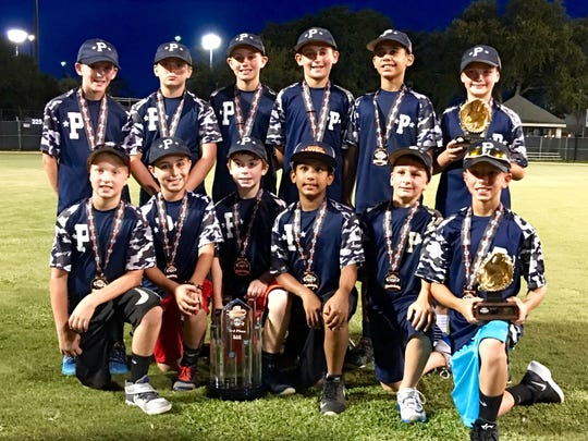 The Poughkeepsie Lightning 10-and-under baseball team with their third-place awards from the Babe Ruth/Cal Ripken World Series