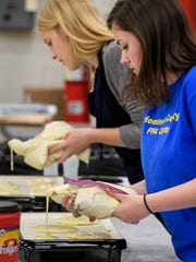 Alexa Young (left) and Jesslyn Watson made pancakes