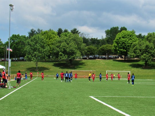 The new soccer turf and striping at Mayor Bob Leonard Park attracts youth soccer leagues like this one, but kids can find pick-up games or just practice on the field.