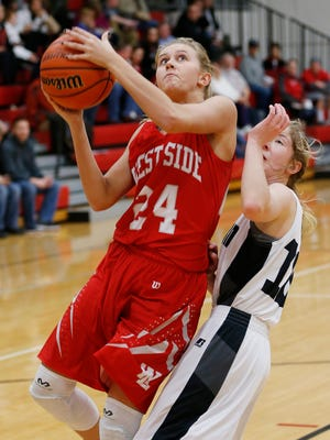 West Lafayette's Julia Bittner gets past Western's Sarah Connolly for a score in the Girls 3A basketball sectional Friday, February 5, 2016, at West Lafayette High School. West Lafayette defeated Western 81-60.