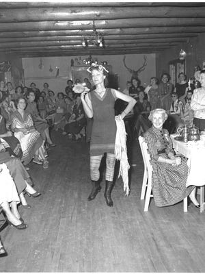 Contact Lyn Kidder at words0250@gmail.com if you can identify the flamboyant lady in the photo.