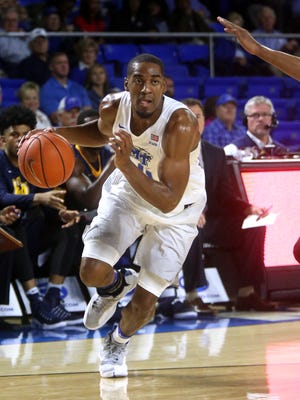 MTSU's Ed Simpson (11) is back to being the busy player he was last season both on and off the court.