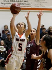 Nocona's Laramie Hayes goes for the layup against Bowie Tuesday, Dec. 19, 2017, in Nocona.