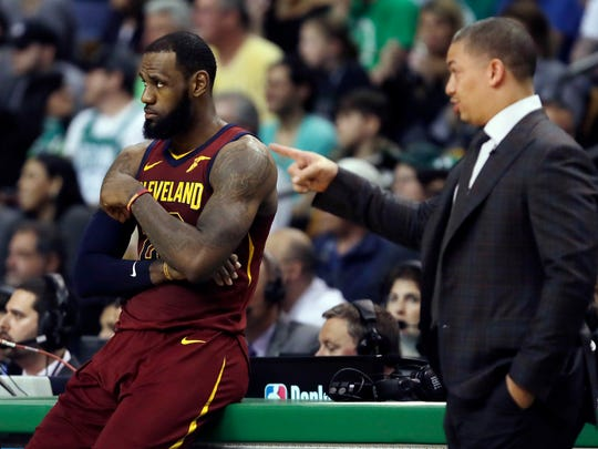 Cleveland Cavaliers coach Tyronn Lue, right, speaks to LeBron James during a timeout in the first half in Game 2 of the  team's NBA basketball Eastern Conference finals against the Boston Celtics on Tuesday, May 15, 2018, in Boston. (AP Photo/Charles Krupa)