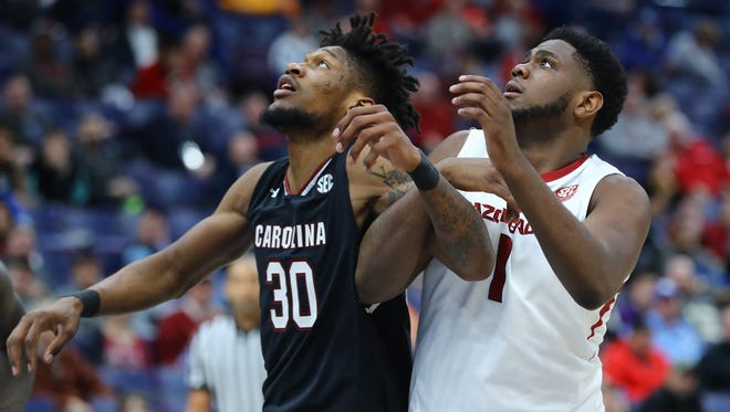 South Carolina Gamecocks forward Chris Silva (30) and Arkansas Razorbacks forward Trey Thompson (1) battle for position on a rebound during the second half in the second round of the SEC Conference Tournament at Scottrade Center in Kansas City, Mo. Arkansas won 69-64.