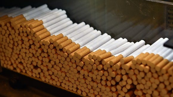 A closeup shot of cigarettes on a manufacturing line.