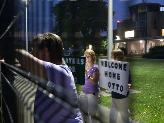 Supporters await an airplane transporting Otto Warmbier,