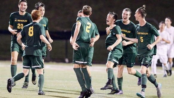 The Reynolds soccer team celebrates after Matthew Kennedy