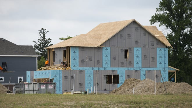 A new home is going up near barns that house businesses, including Triton Brewing Co. As proposals for development of the last parcel at Fort Benjamin Harrison come in, development on other parts of the fort carries on.