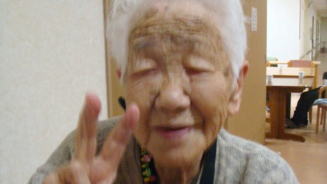 In this Jan. 2, 2018, photo provided by Goodtime Home 1, Kane Tanaka flashes a peace sign during her 115th birthday celebration at her nursing home in Fukuoka, southwestern Japan. Tanaka became the new oldest person in Japan after 117-year-old Japanese woman Chiyo Miyako, the world's oldest person, died on Sunday, July 22, 2018.