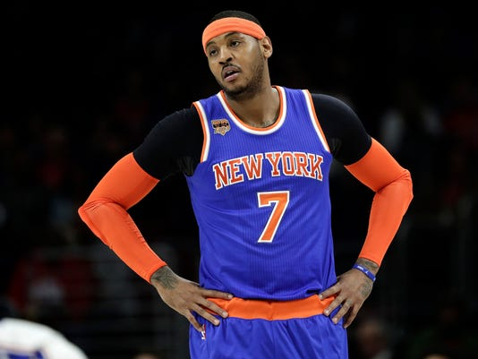 FILE - In this Jan. 11, 2017, file photo, New York Knicks' Carmelo Anthony looks on during a break in an NBA basketball game against the Philadelphia 76ers in Philadelphia. Phil Jackson has made his relationship with Anthony worse and hasn't made the Knicks better. Heading into the trade deadline and nearly three years since he was hired, there are questions if the guy who could do little wrong as a record-setting coach will ever get it right as an executive.  (AP Photo/Matt Slocum, File)
