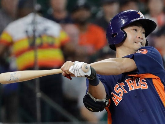 Houston Astros' Norichika Aoki hits a single against