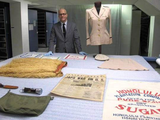 Memorabilia donated by the family of Rhoda Ann Ziesler Weller to the Wisconsin Veterans Museum include her uniform, a Hawaiian grass skirt and a copy of the Dec. 7, 1941, Manitowoc Herald Times that mentions her service.