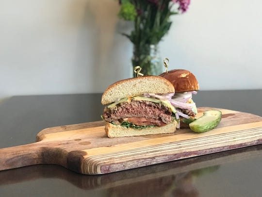 Artisan Eatery's Impossible Burger comes on a vegan