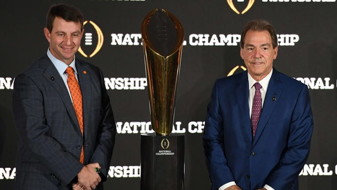 Clemson coach Dabo Swinney (left) and Alabama coach Nick Saban lead their teams in pursuit of the College Football Playoff trophy Monday night.