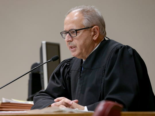 Judge James Piampiano speaks to the jury and tells him that he is declaring a mistrial.