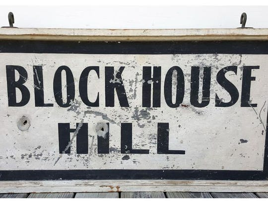 Large Block House Hill double-sided hanging sign, tin with wood frame. This sign was found in 1959 in the garage/icehouse of the David Marvin camp property in Greensboro, now 197 Block House Hill Road, when Daniel B. and Thelma Haslam purchased the camp.